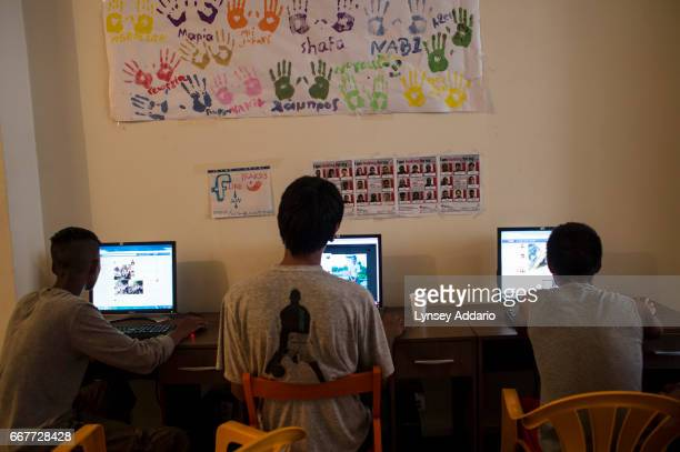 Afghan illegal migrants and asylum seekers check their Facebook pages at the NGO Praksis which provides services to migrant youths at their center at...