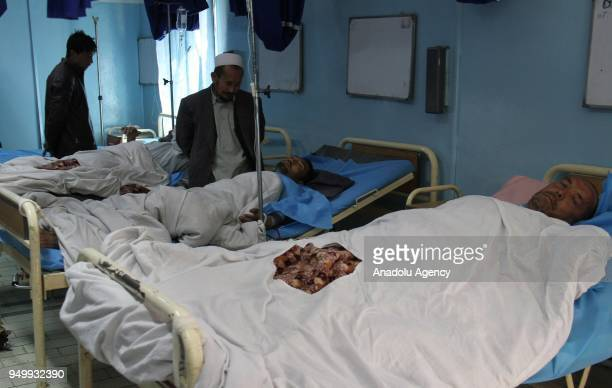 Afghan injuries receive medical treatments at a local hospital after a suicide bomb attack that targeted a voter registration center in Kabul...