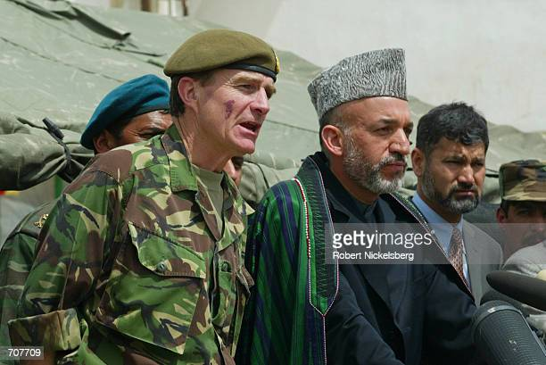 Afghan Interim Leader Hamid Karzai and ISAFs chief military commander, Lt. Gen. McColl , answer questions at a press conference April 3, 2002...