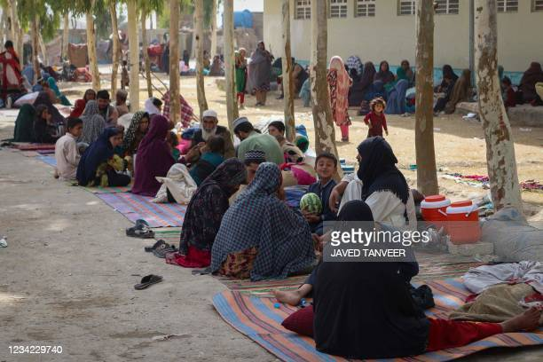 Afghan internally displaced families are pictured upon their arrival from the outskirts Kandahar, who fled due to the ongoing battle between Taliban...