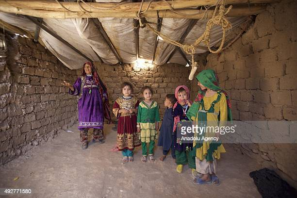 Afghan internally displaced families live at a camp on the outskirts of Herat Afghanistan on October 15 2015 after their family return to their...