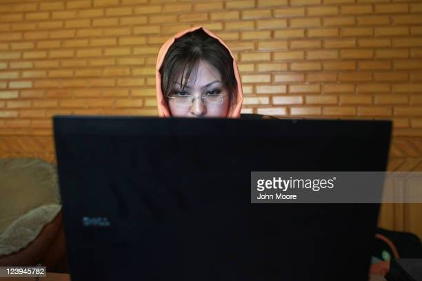 Afghan IT specialist Masuma Asaghari checks antivirus programs on a laptop purchased by USAID for the Afghan Civil Service Commission Appeals Board...