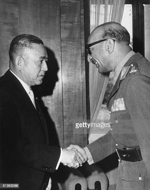 Afghan King Mohammad Zahir Shah is welcomed by Japanese Prime minister Eisaku Sato 10 April 1969 in Tokyo Mohammad Zahir Shah was deposed by his...