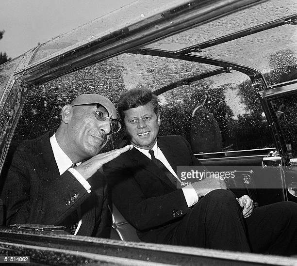 Afghan King Mohammad Zahir Shah talks with US President John F. Kennedy in the car that takes them to the White House 08 September 1963 in...