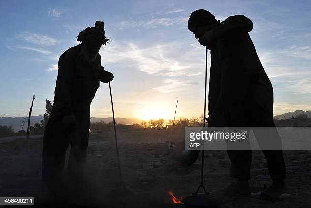 Afghan labourers works at a brick factory on the outskirts of Jalalabad in Nangarhar province on December 13 2013 Over a third of Afghans are living...