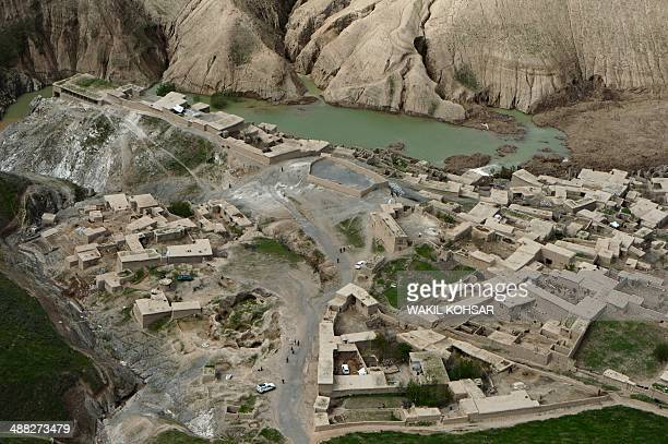 Afghan landslideaffected villagers walk in this aerial photograph of Aab Bareek village at Argo district of Badakhshan on May 5 2014 Afghan officials...