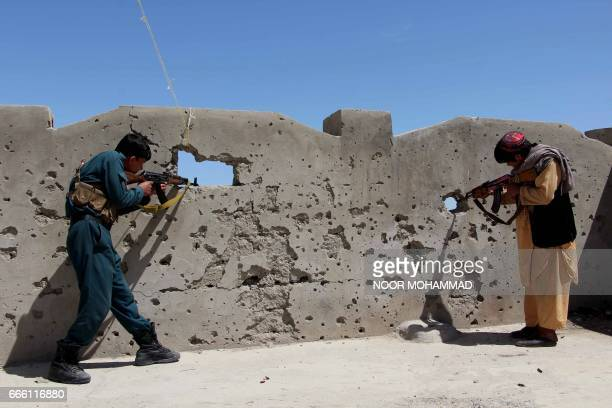 Afghan Local Police official keeps watch during a military operation in Nad Ali district of Helmand province on April 8 2017 The Taliban effectively...