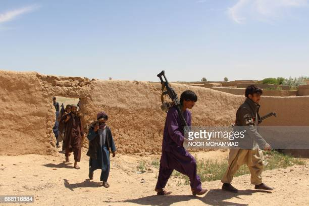 Afghan Local Police official march during a military operation in Nad Ali district of Helmand province on April 8 2017 The Taliban effectively...