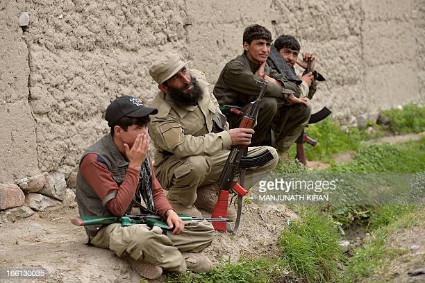 Afghan Local Police personnel wait to accompany US Army soldiers of 3rd platoon, Alfa Company, 1st Battalion, 327th Infantry Regiment of Combined...