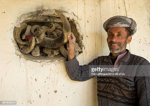 Afghan man showing the ibex horns used during ramadan and nowruz celebrations badakhshan province zebak Afghanistan on August 15 2016 in Zebak...