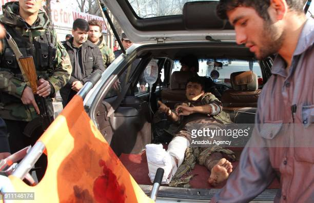 Afghan man who was injured in a bomb explosion is being taken to the hospital in Kabul Afghanistan 27 January 2018 More than 90 people were killed...