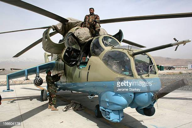 Afghan mechanics serving with the Afghan National Army Air Corps work on the engine of a Soviet designed a Hind Mi35 attack helicopter at Kabul...