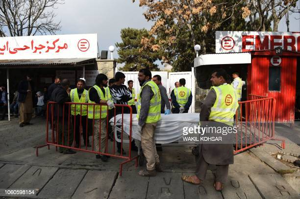 Afghan medical staff members with stretchers wait outside a hospital of the Italian aid organisation 'Emergency' in Kabul on November 12 2018 At...