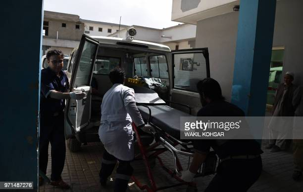 Afghan medical staff transefer a stretcher to an ambulance at the Isteqlal Hospital following a suicide attacker blew himself up among government...