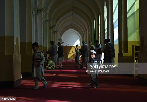 Afghan men and boys attended EidalAdha prayers at the Eid Gah Mosque in Kabul on September 24 2015 Afghans have started celebrating Eid alAdha or...
