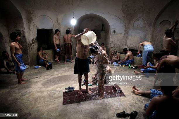 Afghan men and boys bathe in the hot room at a hammam on March 5 2010 in Herat Afghanistan It is traditional for Afghans to visit the hammam on a...