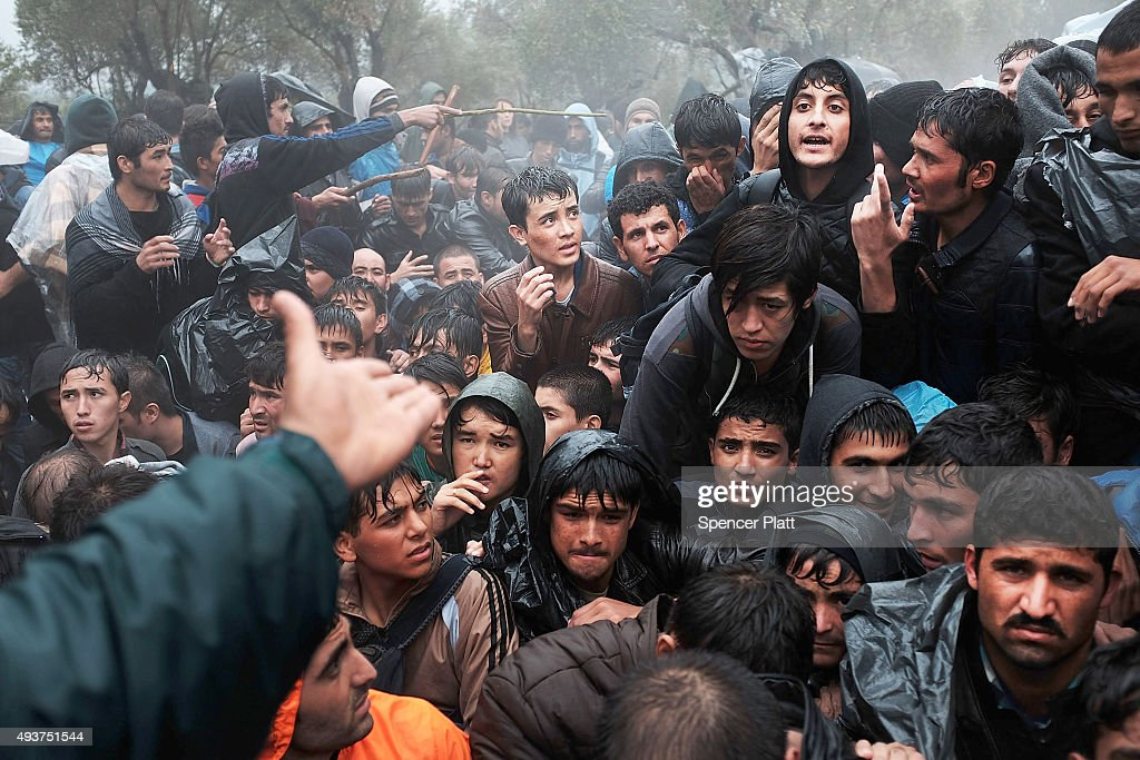 Afghan men argue outside of the main gate as violence escalates for migrants waiting to be processed at the increasingly overwhelmed Moria camp on the island of Lesbos on October 22, 2015 in Mytilene, Greece. Dozens of rafts and boats are still making the journey daily as thousands flee conflict in Iraq, Syria, Afghanistan and other countries. More than 500,000 migrants have entered Europe so far this year. Of that number, four-fifths have paid to be smuggled by sea to Greece from Turkey, the main transit route into the EU. Nearly all of those entering Greece on a boat from Turkey are from the war zones of Syria, Iraq and Afghanistan.