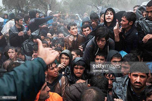 Afghan men argue outside of the main gate as violence escalates for migrants waiting to be processed at the increasingly overwhelmed Moria camp on...