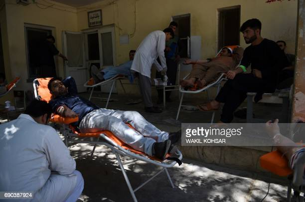 Afghan men donate blood for those injured following a car bomb attack at the Wazir Akbar Khan hospital in Kabul on May 31 2017 At least 80 people...