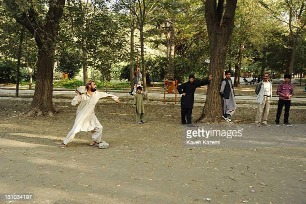 Afghan men enjoy a traditional game of rock throwing in the quiet atmosphere of Shahr-e Now park on October 18, 2011 in Kabul, Afghanistan.