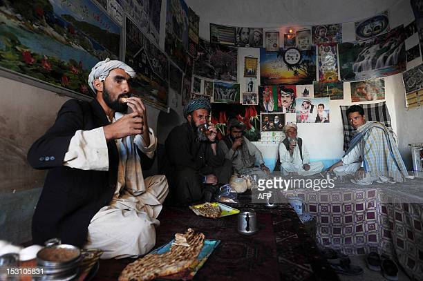 Afghan men enjoy tea and bread at a tea house in the eastern city of Herat on September 30 2012 Tea is a major drink in Afghanistan and in the...