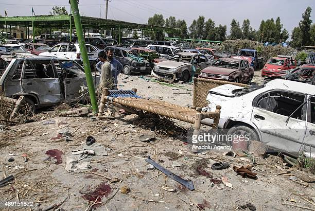 Afghan men gather at the site of a suicide bomb attack targeting a convoy of US forces near Nangarhar airport which is used as a US military base in...