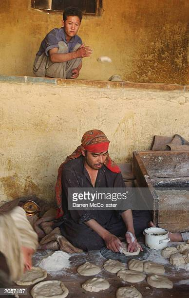 Afghan men make bread at a bread making shop June 5 2003 in Kabul Afghanistan Bread is a staple food in the Afghan diet and is eaten at all three...