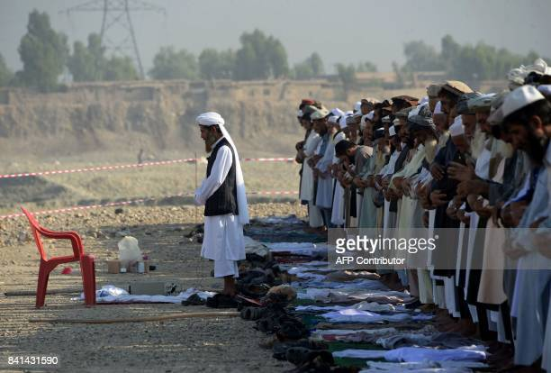 Afghan men offer EidalAdha prayers in Jalalabad on September 1 2017 Afghans have started celebrating Eid alAdha or 'Feast of the Sacrifice' which...