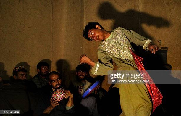 Afghan men perform the Bazi dance to a group of policemen in Charchino in Uruzgan province, Afghanistan, January 27, 2013. The performance is based...