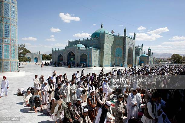 Afghan men pray at the Blue Mosque a day before the parliamentary election September 17 2010 in Mazaresharif Afghanistan Security is of gaining...