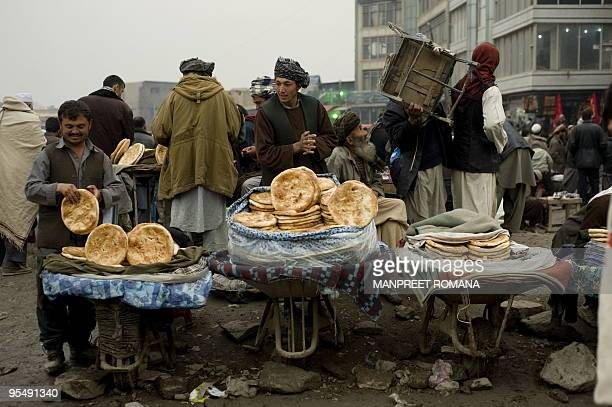 Afghan men sell bread on a street in Kabul on December 3 2009 The US and NATO commander in Afghanistan on December 3 told lawmakers that a new war...