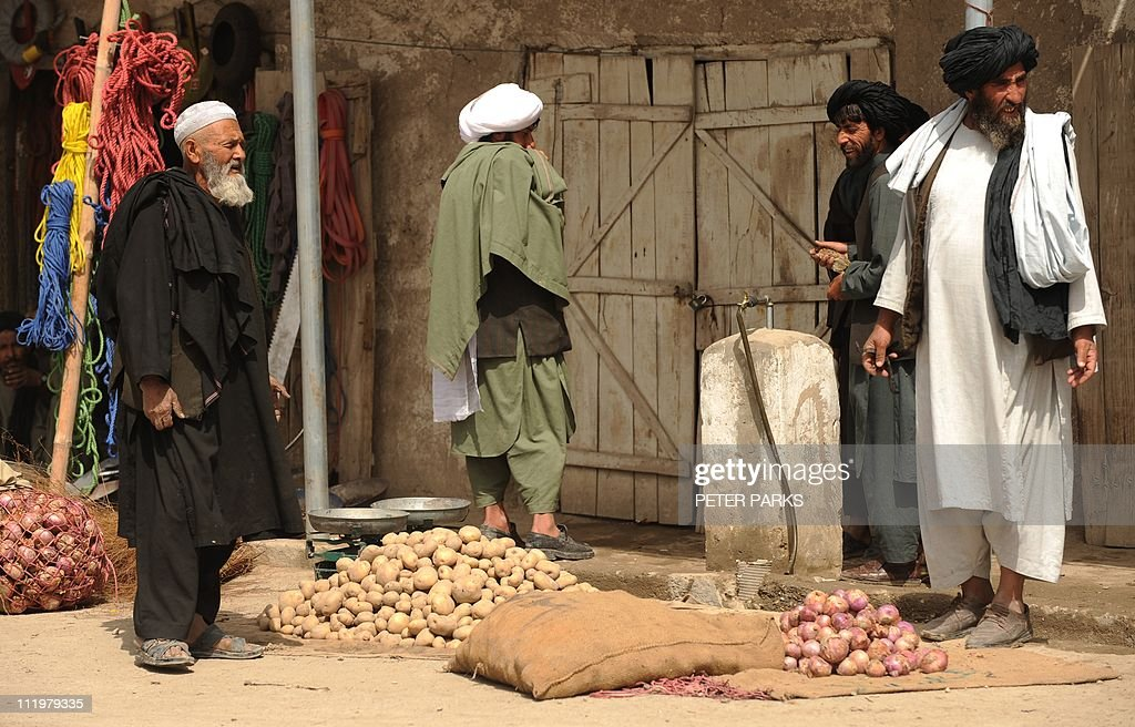 Afghan men sell potatoes on a street in : News Photo