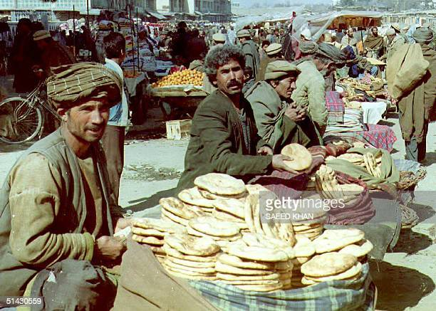 Afghan men sell roti traditional Afghan bread at an open market in downtown Kabul 21 February 1993 Unofficial orders 21 February for a threeday...