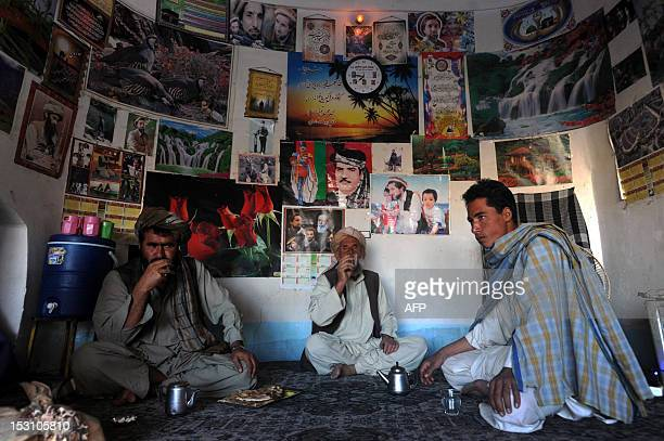 Afghan men sit in a tea house in the eastern city of Herat on September 30 2012 Tea is a major drink in Afghanistan and in the popular tea houses...