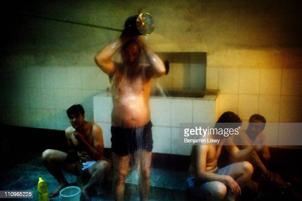 Afghan men talk and bathe in a communal bath on April 16 2007 in Kabul Aghanistan