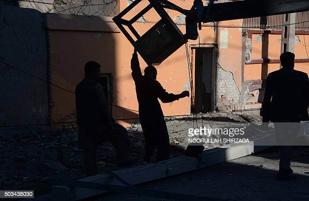 Afghan men walk at the site of a blast near the Indian consulate in Jalalabad on January 5 2016 A small bomb exploded near the Indian consulate in...