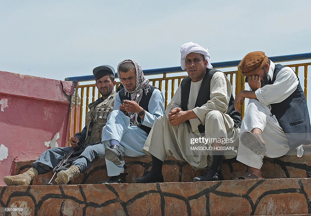 Afghan men who lost relatives in a plane crash wait in Charikar city of Parwan province, north of capital Kabul on May 21, 2010. Bodies and wreckage of an Afghan passenger plane that crashed with 43 people on board have been found on a mountainside with no immediate sign of any survivors, a government minister said. The ageing Pamir Airways plane was carrying three Britons, an American and dozens of Afghans when it came down during bad weather on May 17 during a scheduled flight from the northern province of Kunduz to Kabul. AFP PHOTO/Massoud HOSSAINI