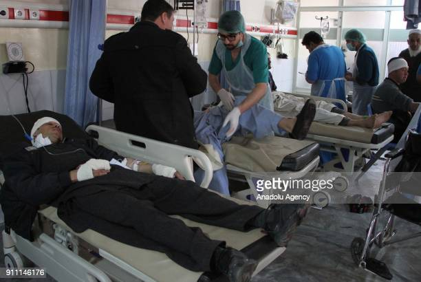 Afghan men who were injured in a bomb explosion receives medical treatment at a hospital in Kabul Afghanistan 27 January 2018 More than 90 people...