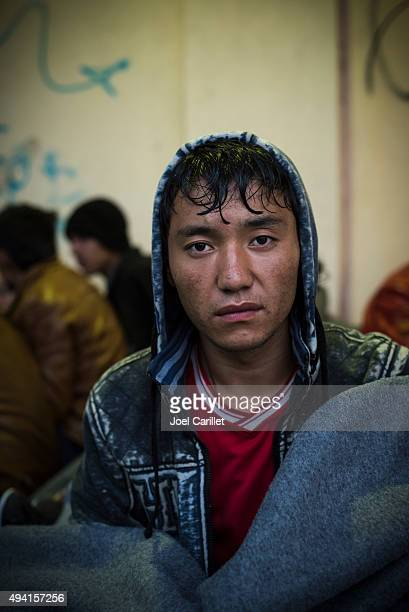 afghan migrant waiting for ferry in lesvos, greece - afghanistan stock pictures, royalty-free photos & images