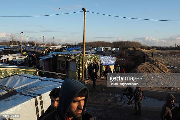 Afghan migrants are seen outside the 'Jungle' migrant camp on February 23 2016 in Calais France Plans to evacuate hundreds of migrants from the...