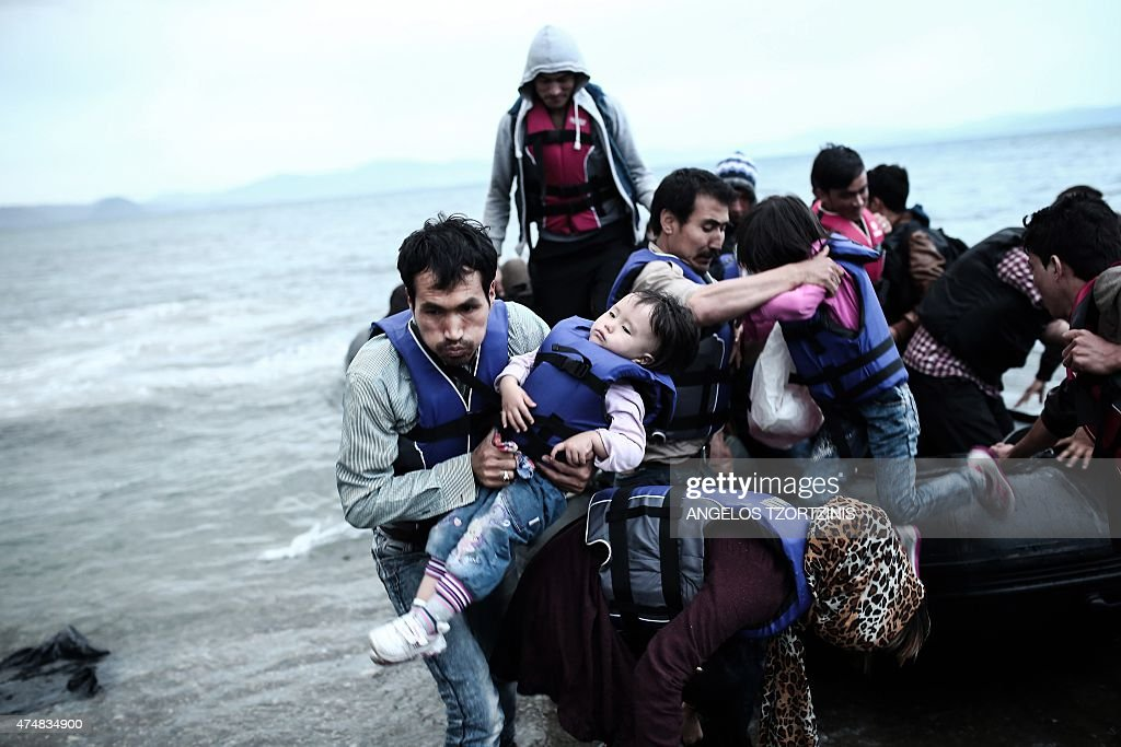 Afghan migrants arrive on a beach on the Greek island of Kos, after crossing a part of the Aegean Sea between Turkey and Greece, on May 27, 2015. AFP PHOTO / Angelos Tzortzinis