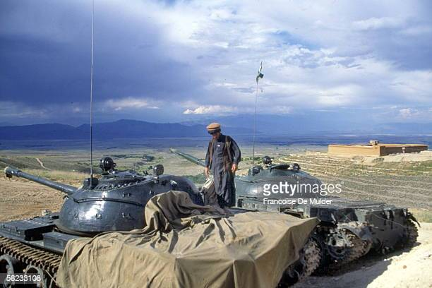 Afghan military chief on a tank At the back feudal castle Valley of Zawa Afghanistan 1995