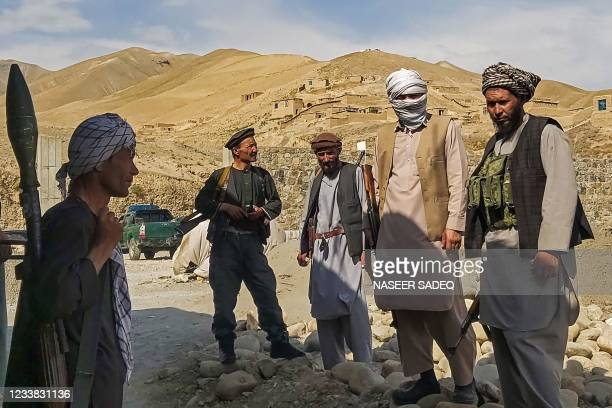 Afghan militia forces stand guard at an outpost as they patrol against the Taliban fighters in the Tange Farkhar area of Taloqan in northern Takhar...