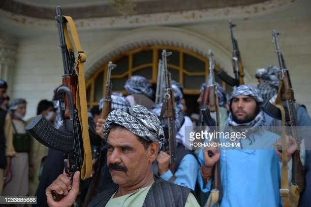 Afghan militia gather with their weapons to support Afghanistan security forces against the Taliban, in Afghan warlord and former Mujahideen leader...
