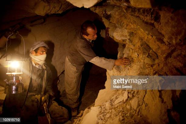 Afghan miners work in a makeshift emerald mine in The Panjshir Valley on July 14 2010 Reports sugest that Afghanistan is sitting on significant...