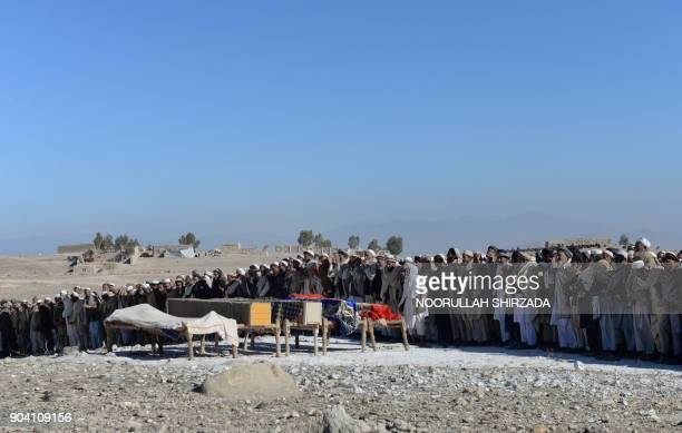 Afghan mourners offer funeral prayers for the victims of a suspected US airstrike in the Achin district of Nangarhar province on January 12 2018...