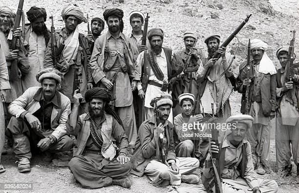 Afghan mujahideen leader Amin Wardak surrounded by his combatants fights against the Afghan communist regime and the Soviet invaders in his home...