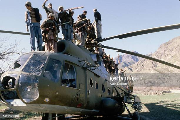 Afghan Mujahideen standing on a destroyed Russian helicopter They fought against the Soviet invasion of Afghanistan during the 1980s The invasion...