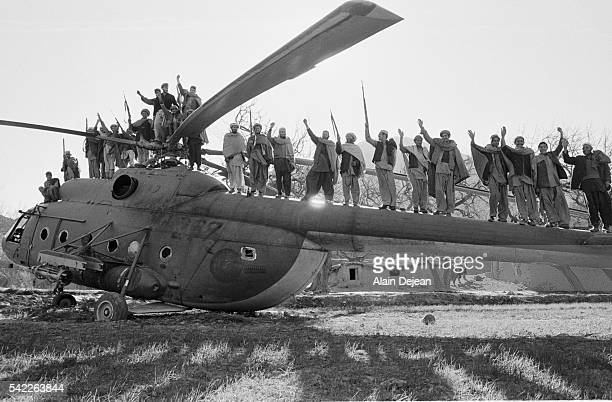 Afghan Mujahideens standing on a destroyed Russian helicopter They fought against the Soviet invasion of Afghanistan during the 1980s The invasion...