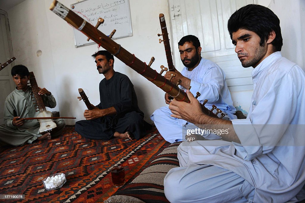 Afghan music students play the sitar in Herat on August 21